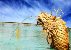 The dragon being spray water. Stock Photos