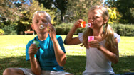 Siblings having fun with bubbles Stock Footage