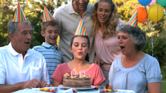 Happy family celebrating a birthday and clapping hands - stock footage