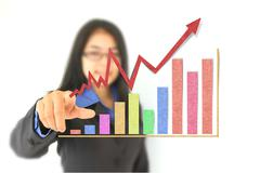 Business woman drawing a graph . Stock Photos