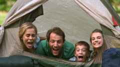 Happy family having fun together in a tent - stock footage