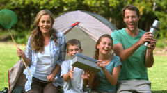 Happy family dancing in front of the tent - stock footage