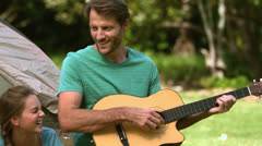 Father playing guitar for his family - stock footage