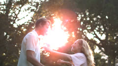 Smiling man holding his wife and turning Stock Footage