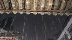 Heavy rain downpouring from the eaves Stock Footage