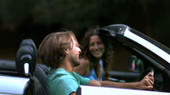 Man closing up his car door while his girlfriend look at him - stock footage
