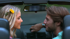 Couple kissing in the car Stock Footage
