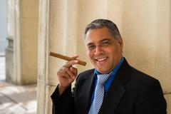 handsome cigar smoker - stock photo