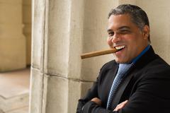 Handsome cigar smoker Stock Photos