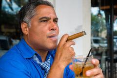 Cigar smoker Stock Photos