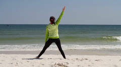 Woman Beach Stretching Stock Footage