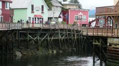 Tourists shopping Ketchikan Alaska Creek Street river HD 7588 Stock Footage