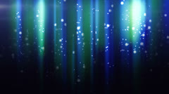 Blue particles flying in light beams loop Stock Footage