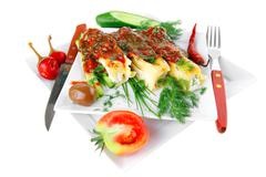 cannelloni served on square white plate - stock photo
