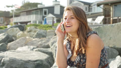 Young Woman Talking on Cell Phone at Beach Front Property Stock Footage