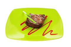 Stock Photo of meat savory : grilled beef fillet mignon on green plate