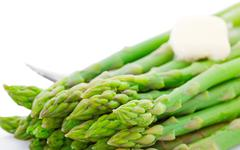 Cooked asparagus with butter Stock Photos
