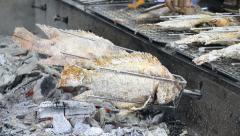 Roast fish mix with salt on stove machine Stock Footage