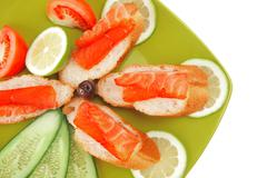 Sandwich with salmon on green Stock Photos