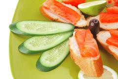 Smoked salmon with tomatoes and lemon Stock Photos