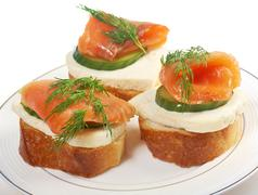 canapes with smoked salmon  cheese and cucumber - stock photo