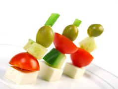 Stock Photo of canape platter with cheese, cucumber,tomato,olives