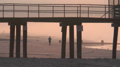 Ocean city nj jogger on beach Stock Footage