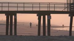 Ocean city nj jogger on beach Stock Footage