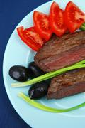 Stock Photo of meat savory : grilled beef fillet mignon on blue plate