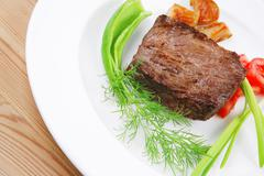 Stock Photo of meat savory : grilled beef fillet mignon on white plate with sprouts