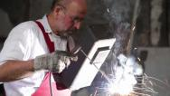 Stock Video Footage of A man welds a cusp and shows thumb up