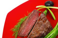 Stock Photo of meat food : roast beef fillet mignon served on red