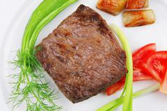Stock Photo of meat food : roast beef fillet mignon served on white with sprouts