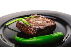 Stock Photo of meat savory : grilled beef fillet mignon on black plate