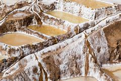 peru, salinas de maras, pre inca traditional salt mine (salinas). - stock photo