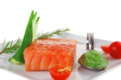Fresh smoked salmon fillet with pesto sauce Stock Photos