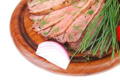 hot beef on wooden plate - stock photo