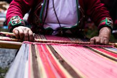 Traditional hand weaving in the andes mountains, peru Stock Photos