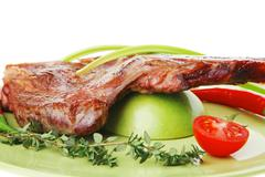 savory : grilled spare rib on green dish with pepper and tomato - stock photo