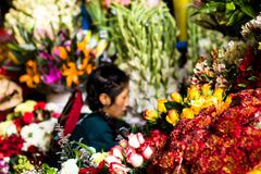 Flowers for sale at peruwian market in south america. Stock Photos