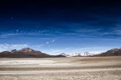 Desert and mountain over blue sky and white clouds on altiplano,bolivia Stock Photos