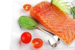 salmon fillet with pesto sauce - stock photo