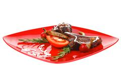 Served entree: ribs on red plate Stock Photos