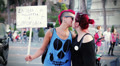 two lesbians kissing in the street demonstrating for their rights - gay pride HD Footage