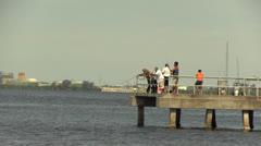 Men fishing off Tampa Bay pier Stock Footage