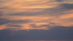 Lovely slow moving pink clouds at dusk time lapse 4K version Stock Footage