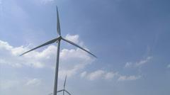 Wind turbines in blue sky, cumulus clouds - stock footage