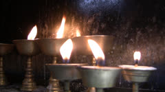 Candles at Holiness Dalai Lama monastery, Mc Leod Ganj-Dharamsala - stock footage
