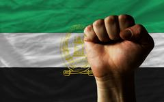 Hard fist in front of afghanistan flag symbolizing power Stock Photos