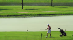 Woman playing golf Stock Footage